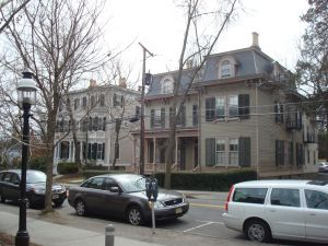Single family homes on University Place co-exist with taller University housing.