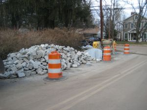 Pile of Belgian blocks on Cuyler Rd, waiting to be assembled into new sidewalks on Ewing St.