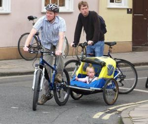 One way to bring your kids with you! (Via cyclinginfo.co.uk)