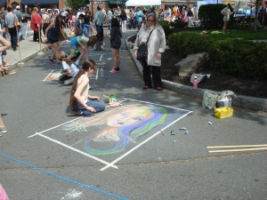 Artists work with chalk on the street at Communiversity 2013