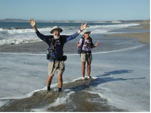 Ken and Marcia Powers celebrate in the breakers of the Pacific Ocean after walking the length of the American Discovery Trail.