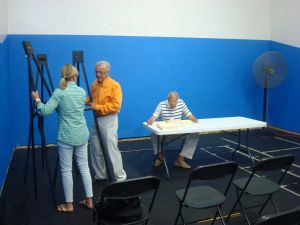 Robert and Barbara Hillier set up their presentation at the Princeton YMCA July 27, as Chair Jim Floyd looks on. (Click to expand.)