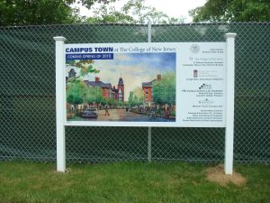 Big plans: The hoardings are up ready for construction of Campus Town at TCNJ. (Click image to expand.)