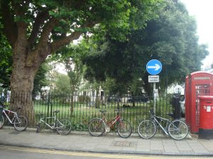 Park at Pelham Square in Brighton. Note the many bicycles chained to the fence. (Click to expand)