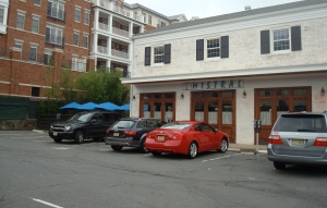 Mistral restaurant in downtown Princeton: a surface parking lot out front, diners squeezed in around the back. (Click to expand.)