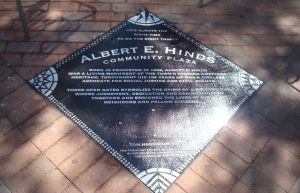 The new memorial to Albert E. Hinds at Hinds Plaza. The text reads: ""