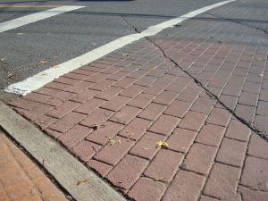 A 'stamped asphalt' crosswalk kinda looks like brick, but isn't. (Click to expand)