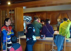 Steve Cochrane (at left in blue and red jersey) chats to Princeton neighbors over hot cider in Mountain Lakes House. (click to expand.)
