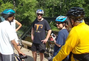 Princeton Mayor Liz Lempert (center, holding cell phone) consults with local transportation officials  while checking out a new cycle route in Princeton earlier this year. (Click to expand.)