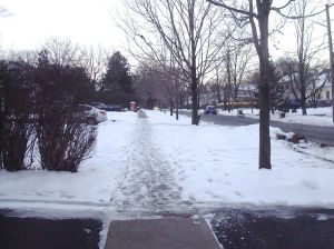 Un-shoveled sidewalks make for a treacherous surface for walkers. (Click to expand.)