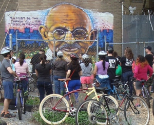 Riders inspect a mural of Mahatma Ghandi during the Trenton Social Ride. 'Ghandi Garden' is a project of the S.A.G.E. coalition, who are planning a mural at Princeton's Paul Robeson Center. (click to expand).