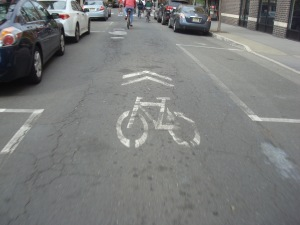 An example of 'shared lane markings' or 'sharrows'. (click to expand)